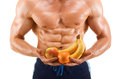 Shaped and healthy body man holding a fresh fruits shaped abdominal isolated on white background Royalty Free Stock Photos