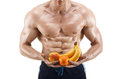 Shaped and healthy body man holding a fresh fruits shaped abdominal isolated on white background Stock Image