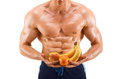 Shaped and healthy body man holding a fresh fruits shaped abdominal isolated on white background colored retouched Royalty Free Stock Image