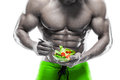 Shaped and healthy body man holding a fresh salad bowl abdominal isolated on white background colored retouched Royalty Free Stock Photo