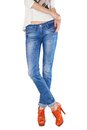 Shapely female legs dressed in blue jeans and orange boots with high heels on white background Royalty Free Stock Images