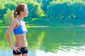 Shapely toned woman in sportswear rest on the nature Royalty Free Stock Photos