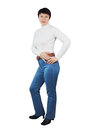 Shapely woman dressed white knitted turtleneck blue jeans isolated over white Royalty Free Stock Photo