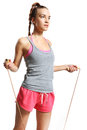 Shapely woman exercising with a jump rope happy Stock Photography