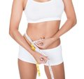 Shapely woman measuring her waist Royalty Free Stock Photo