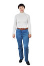 Shapely woman wearing blue jeans white turtleneck isolated over white Stock Photo
