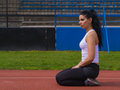 Shapely young woman fitness sitting her feet Royalty Free Stock Photo