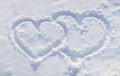The shapes of heart on the snow closeup shot Stock Photo