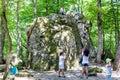 Tourists near Devil`s Finger rock in Shapsugskaya Royalty Free Stock Photo
