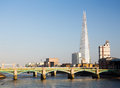 The shard towering over river thames london uk april towers skyline of on april tower at feet high is tallest building in european Royalty Free Stock Image