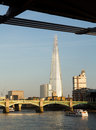 The shard towering over river thames london uk april towers skyline of on april tower at feet high is tallest building in european Stock Photo