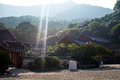 Shards of sunlight bless korean temple building daylight colour in mountains Royalty Free Stock Photo