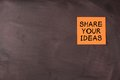 Share your ideas note pasted on blackboard which can be background for edit Stock Photo