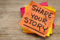 Share your story on sticky note suggestion a against grained wood Royalty Free Stock Photos