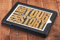 Share your story word abstract isolated text in vintage letterpress wood type on a digital tablet against rustic red barn wood Royalty Free Stock Photos
