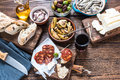 Sharing authentic spanish tapas with friends in bar restaurant or view from above Royalty Free Stock Photo