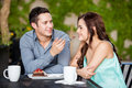 Sharing a cake with my girlfriend handsome young men his beautiful date at restaurant outdoors Royalty Free Stock Photo