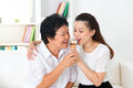 Sharing food happy asian family an ice cream at home beautiful senior mother and adult daughter eating dessert together Stock Photography