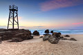 Shark watch tower and jagged rocks australia the at redhead beach nsw Royalty Free Stock Photo