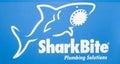 SharkBite company logo. Printed sticker letters