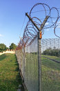 Sharp barbed wire on security fence protecti secure private spac Royalty Free Stock Photo
