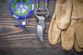 Sharp garden pruner safety gloves soft twist tie on wood board a Royalty Free Stock Photo