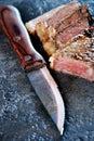 Sharp knife and juicy steak Royalty Free Stock Photo