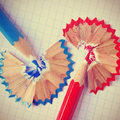 Sharp pencil crayons with a retro effect of different colors and shavings on quadrille paper filter Stock Photography