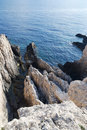 Sharp Rocks and Sea Stock Image