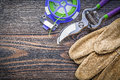 Sharp secateurs safety gloves soft twist tie on wooden board agr Royalty Free Stock Photo