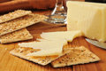 Sharp vermont white cheddar cheese with flatbread crackers Stock Photo