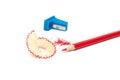 Sharpened pencil, shavings and sharpener Royalty Free Stock Photo