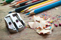 Sharpener and pencil shaving on wooden desk Royalty Free Stock Photo
