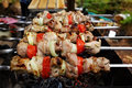 Shashlik closeup on skewers roast over burning coals Stock Photo