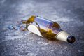 Shattered brown beer bottle: Royalty Free Stock Photo
