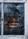 Shattered glass window in front of a brick wall Royalty Free Stock Photos