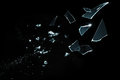 Shattered and splitted glass Pieces isolated on black Royalty Free Stock Photo