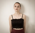 Shaven Bald Teenage Girl With Black Top and Bare Shoulders Royalty Free Stock Photo