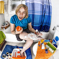 Shaving legs comic situation of a woman her fisheye photo Royalty Free Stock Image