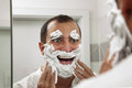 Shaving make me fun portrait of a man with cream on his face Royalty Free Stock Image
