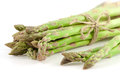 Sheaf of ripe green asparagus on a white background Stock Photos