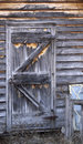 Shed door an old wooden falling in disrepair Stock Photos