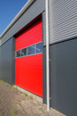 Shed doors a red door in a business building Royalty Free Stock Photo