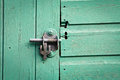 Shed lock metal bolt on a blue painted door Stock Images