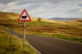 Sheep roadsign of a rural road into the cairngorms in scotland uk Stock Images