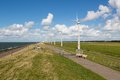 Sheep, sea and wind turbines Stock Photos