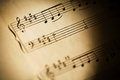 Sheet music detail notation composition over years old Royalty Free Stock Image