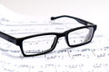 Sheet music and glasses Royalty Free Stock Photo