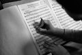 Sheet music member of an orchestra making annotations on their Stock Image