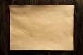 Sheet old vintage paper on the aged wooden background. Royalty Free Stock Photo